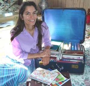Deborah Thompson with some of her many journals.